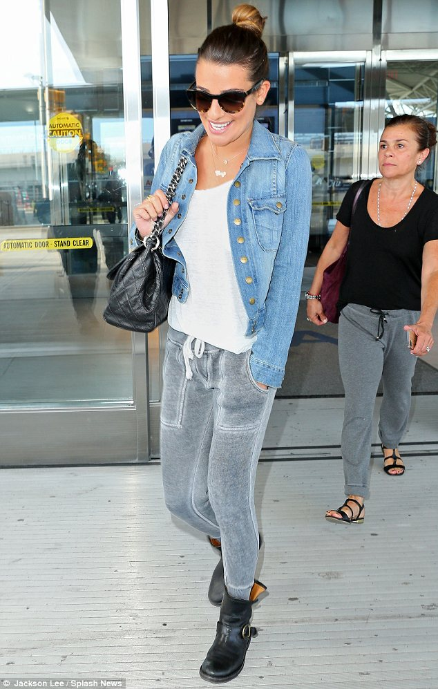 Lea Michele flashes a brave smile as she makes her first trip to New York since tragic death of Cory Monteith